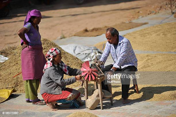 Nepalese people arranging electronic machine fan for winnowing to separates rice grains from the glumes or husks at Bhaktapur Nepal on Wednesday...