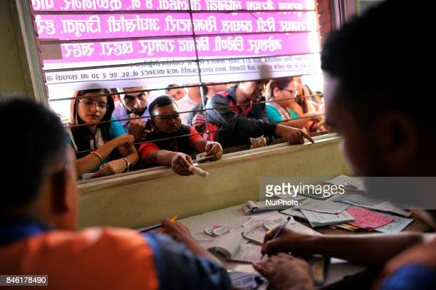 Nepalese People booking tickets after waits in queue for the upcoming Biggest Dashain Festival celebration at New Bus park Kathmandu Nepal on Tuesday...