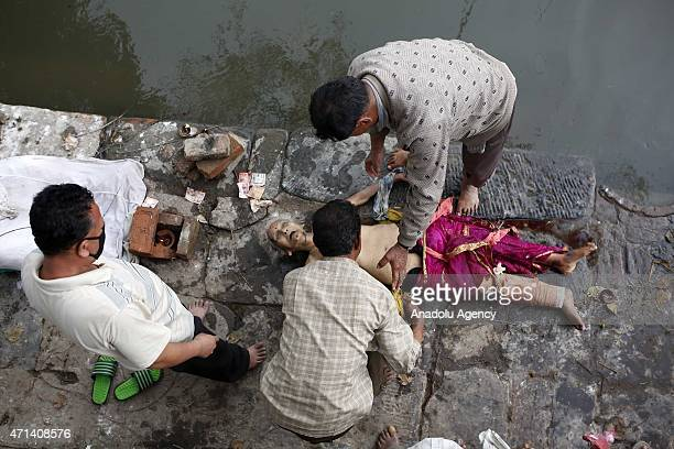 Nepalese people burn the dead bodies of earthquake victims in traditional way in Bhaktapur after a powerful earthquake on April 28 2015 The death...