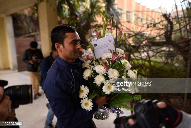 A Nepalese people carrying flower bouquet to Prime Minister after successful second time Kidney transplant of Prime Minister KP Sharma Oli at...