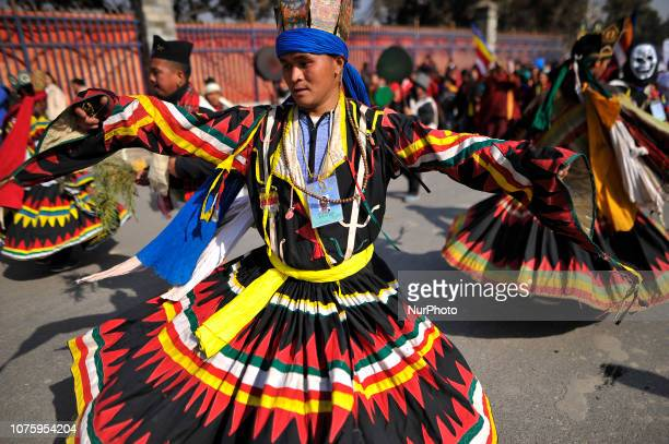 Nepalese people from ethnic Gurung community dance in the tunes of traditional instruments in the rally during Tamu Lhosar or New Year celebrated in...