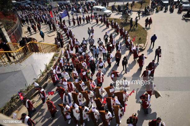 Nepalese people from ethnic Gurung community participate in the rally during Tamu Lhosar or New Year celebrated in Kathmandu Nepal on Sunday December...