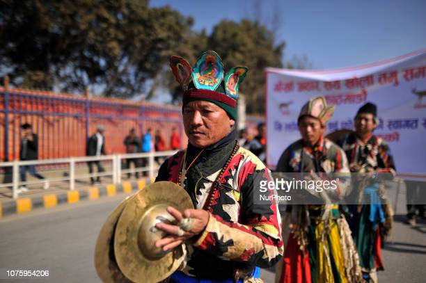 Nepalese people from ethnic Gurung community playing traditional instruments in the rally during Tamu Lhosar or New Year celebrated in Kathmandu...