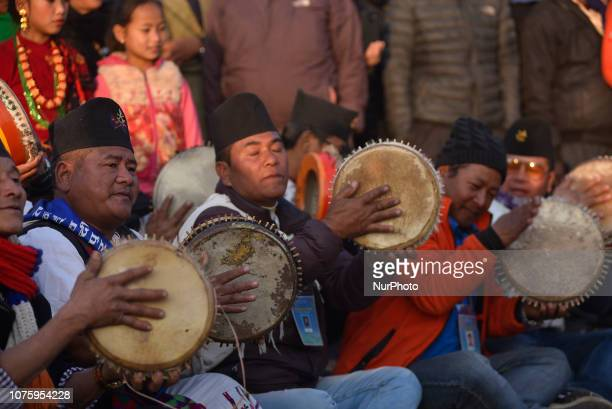 Nepalese people from ethnic Gurung community playing traditional instruments during Tamu Lhosar or New Year celebrated in Kathmandu Nepal on Sunday...