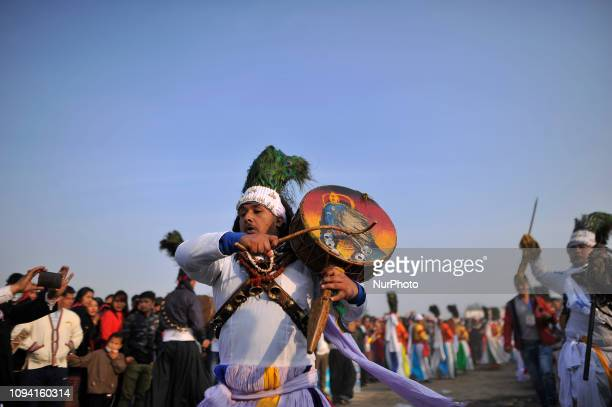 Nepalese people from Tamang community plays traditional instruments during celebration of Sonam Losar festival or Lunar New Year which occurs around...