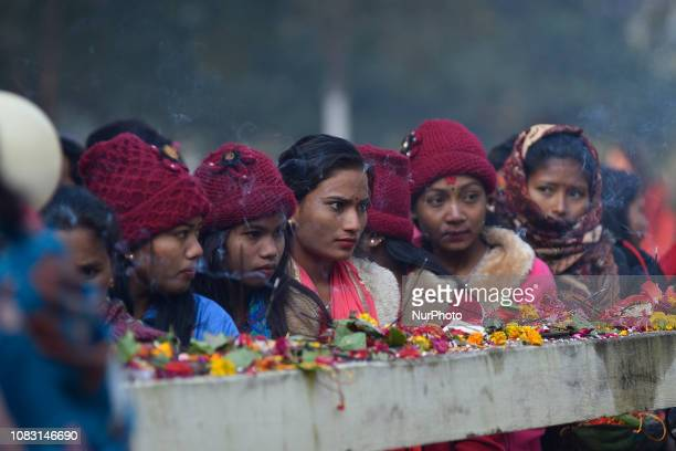 Nepalese people from tharu community lining to offer ritual prayer in Thakur Bata temple during the Maghi festival celebrations or the New Year at...