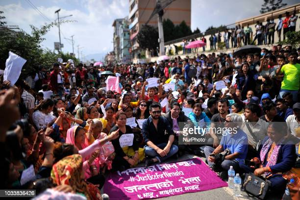 Nepalese people gathered and holds placards chants slogans in the mass rally of 13yrs old Nirmala Panta who was raped and murdered 50 days ago in...