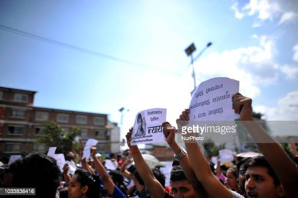 Nepalese people holds placards and chants slogans in the mass rally of 13yrs old Nirmala Panta who was raped and murdered 50 days ago in Kanchanpur...