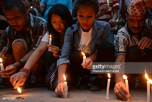 Nepalese people light candles in memory of the 16 Nepalese Sherpa guides killed in an avalanche on Mount Everest in Katmandu on April 30 2014 An...
