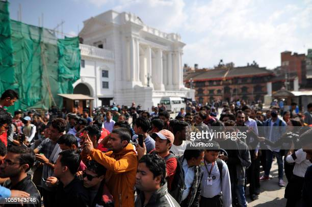 Nepalese people lining to see the 2019 ICC Cricket World Cup trophy in Basantapur Durbar Square during a country tour in Kathmandu Nepal on Monday...