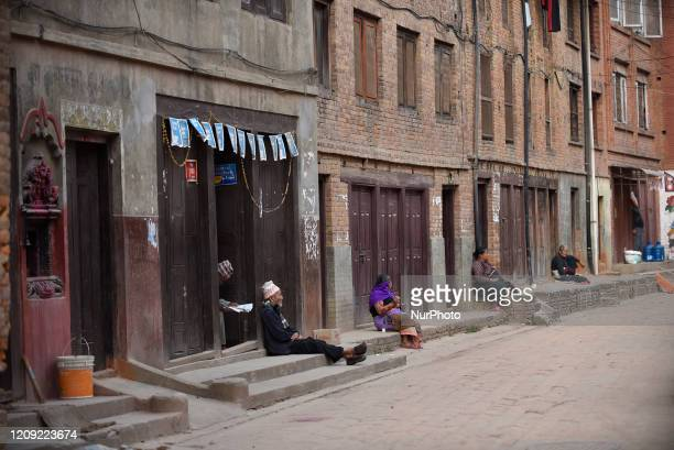 Nepalese people maintaing social distance outside their hoise during lockdown as concerns about the spread of Corona Virus at Bhaktapur, Nepal on...