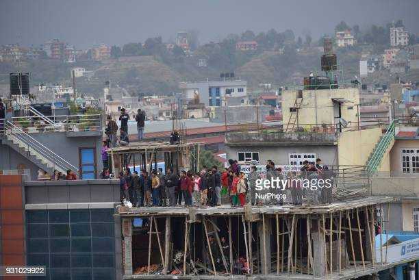 Nepalese people observing the airplane that crashed in Kathmandu at Kathmandu Nepal on Monday March 12 2018