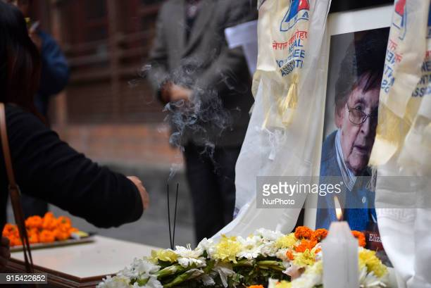 Nepalese people offering flower towards poster of Legendary Elizabeth Hawley during the condolence meeting at Nepal Tourism Board Kathmandu Nepal on...