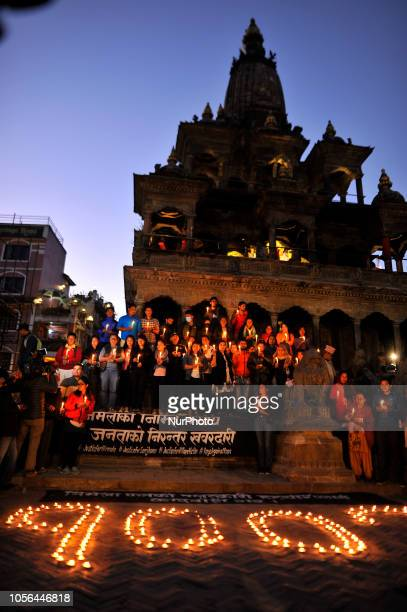 Nepalese people participate in a candle light vigil on the memory of Nirmala Panta in 100th day at the premises of Krishna Mandir Patan Nepal on...