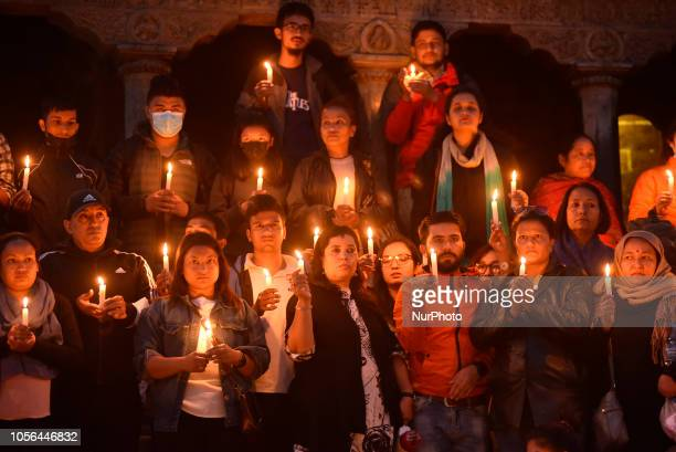 Nepalese people participate in a candle light vigil on the memory of Nirmala Panta in 100th day at the premises of Krishna Temple Patan Nepal on...
