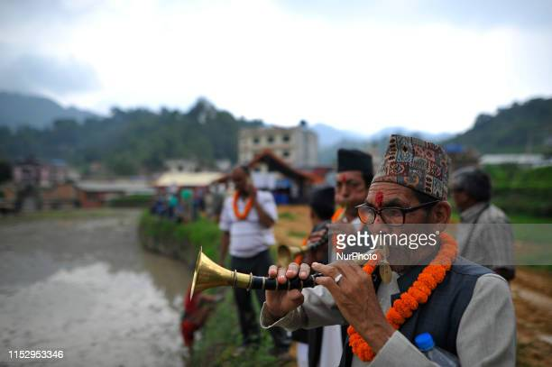 A Nepalese people plays traditional instruments to commence rice plantation at Lele Lalitpur Nepal on Sunday June 30 2019 Nepalese people celebrates...
