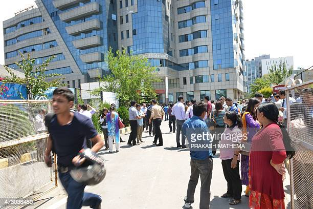 Nepalese people stand in the streets as a 74 magnitude earthquake hits the country in Kathmandu on May 12 2015 A 74magnitude earthquake hit...