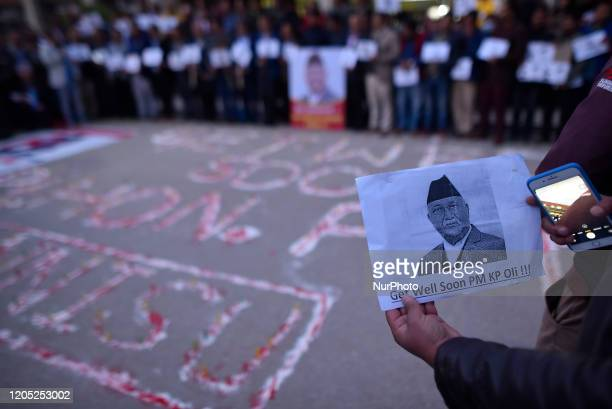 A Nepalese people supporters and political party members holds poster of PM KP Sharma Oli during lighting candle with the slogan GET WELL SOON Rt HON...