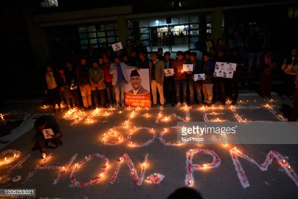 A Nepalese people supporters and political party members light on a candle with the slogan GET WELL SOON Rt HON PM at the hospital premises after...