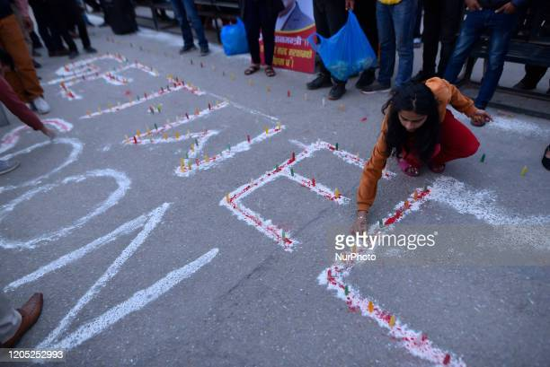 A Nepalese people supporters arrange for the candle light with the slogan GET WELL SOON Rt HON PM at the hospital premises after successful second...