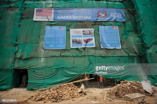 Nepalese people working on the Restoration of Gaddi Baithak which was destructed on April 25 2015 Gorkha Earthquake remembered during third...