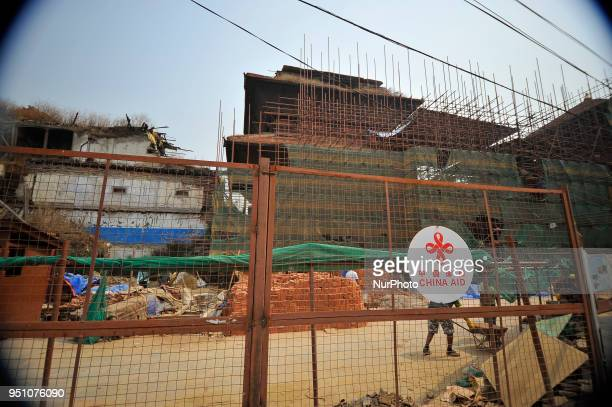 Nepalese people working on the Restoration of NineStoryed heritage site supported by China Aidduring third earthquake anniversary in Kathmandu Nepal...