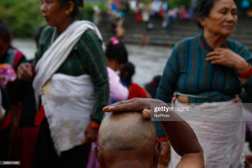 Nepalese perform rituals to their deceased father early morning on the bank of Bagmati River at Gokarna Temple during Kuse Aunsi, or Nepalese Fathers Day in Kathmandu, Nepal on August 21, 2017. Kuse Aunsi is a unique festival of Nepal where fathers living as well as deceased are honored.