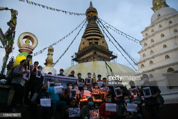 Nepalese Photojournalists hold placards during a candlelight vigil to pay tribute to Reuters photojournalist Danish Siddiqui, in front of the...