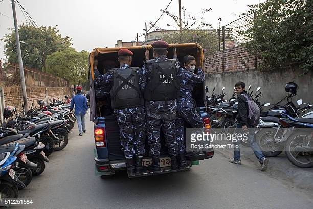 Nepalese police guard the jeep with the bodies of Nepalese plane crash victims after a rescue team brought to Kathmandu by helicopters the bodies of...