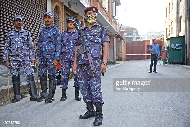 Nepalese Police officers stand guard outside the Indian Embassy in Kathmandu on September 30 2015 Nepalese are facing an acute crisis of petroleum...