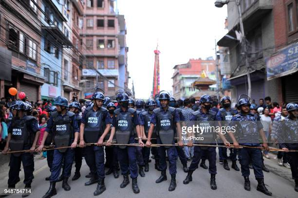 Nepalese police personnel giving secutiry infront of chariot during chariot pulling festival of Rato Machindranath 'God of Rain' on first day at...