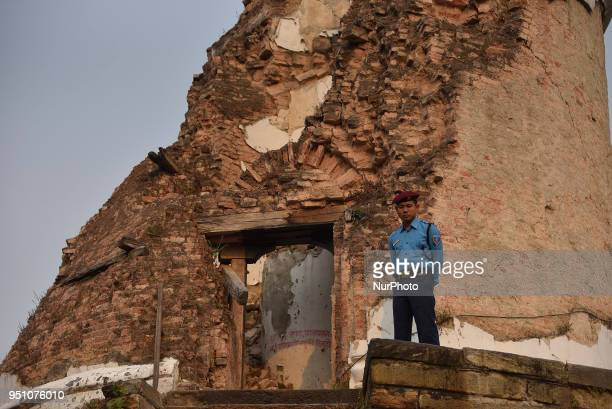 Nepalese Police personnel guard around a reminisce part of historic tower Dharahara knocked down on April 25 2015 Gorkha Earthquake remembered during...