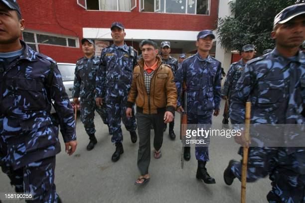 Nepalese police walk with 25year old Padam Kunwar who was arrested for slapping Unified Communist Party of Nepal Chairman Pushpa Kamal Dahal in...