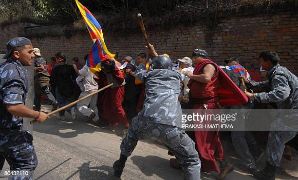 Nepalese policemen baton charge Tibetan monks during an antiChinese demonstration in front of the consular section of the Chinese Embassy in...