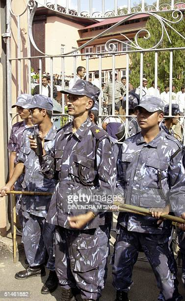 Nepalese policemen guard the gate to the Supreme Court in Kathmandu 11 October 2004 before former Nepalese Prime Minister and President of the Nepali...