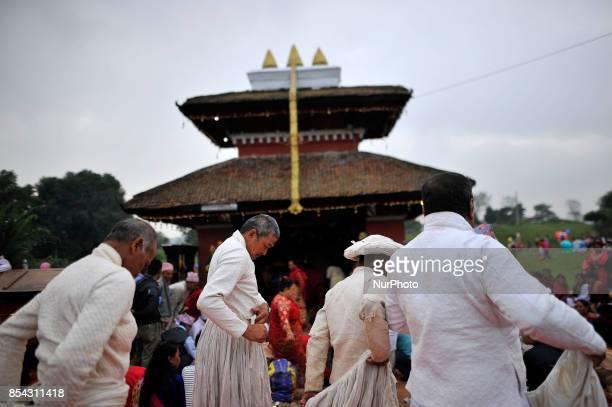 Nepalese priest arranging traditional attire at the premises of Shikali Temple during the celebration of Shikali Festival at Khokana Village Patan...