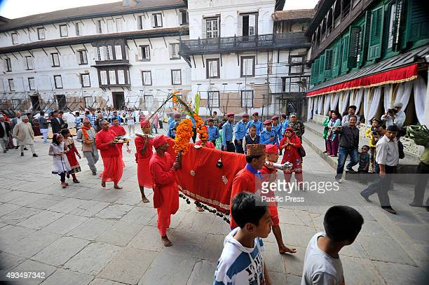 Nepalese priest carrying Fulpati towards Dashain Ghar after performs traditional rituals which was brought from Gorkha during the seventh day of...