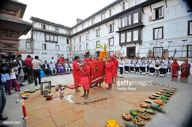 Nepalese priest performs traditional rituals over the Fulpati which was brought from Gorkha during the seventh day of Dashain Festival from Gorkha to...