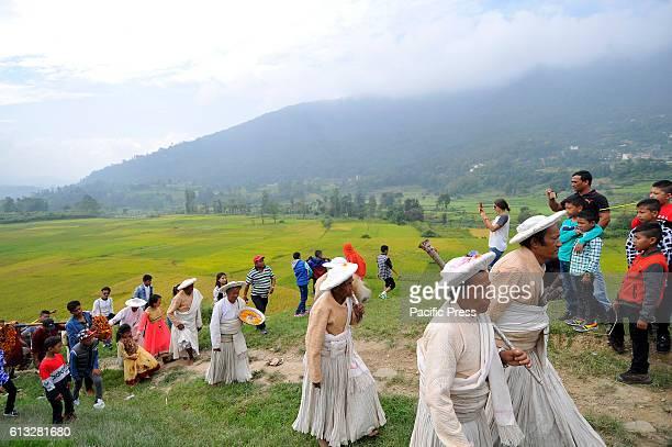 KHOKANA PATAN PATAN NP NEPAL Nepalese priests going towards Shikali Temple for the celebration of Shikali Festival at Khokana Village People living...