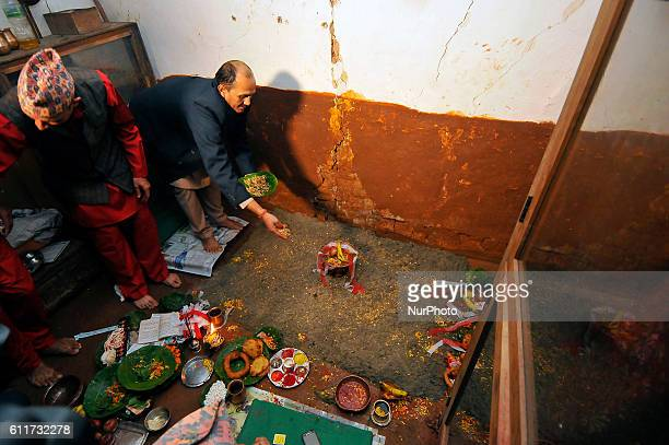 Nepalese Priests spreading barley seeds to grow as 'Jamara' a religious holy flower as the offering of Goddess Durga during the Gatasthapana first...