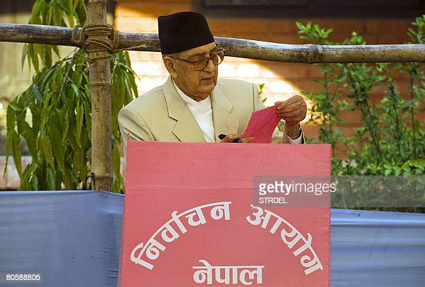 Nepalese Prime Minister Girija Prasad Koirala cast his vote at a polling station in Biratnagar constituency number 7 some 200 kilometers from...
