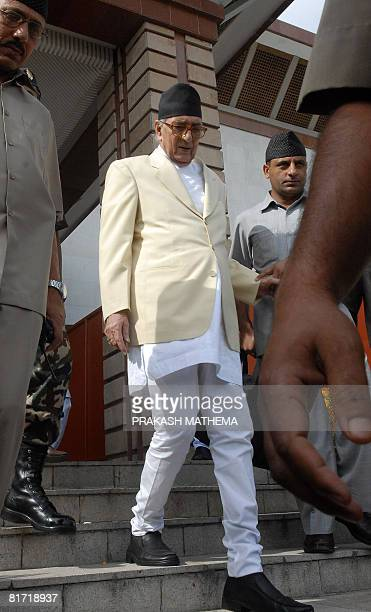 Nepalese Prime Minister Girija Prasad Koirala leaves Parlament after announcing his resignation in Kathmandu on June 26 2008 Nepal's interim premier...