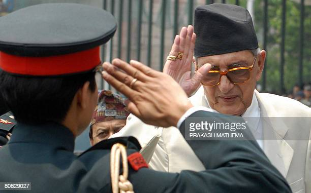 Nepalese Prime Minister Girija Prasad Koirala receives a salute from an army officer at The Army Parade Ground during celebrations for Democracy Day...