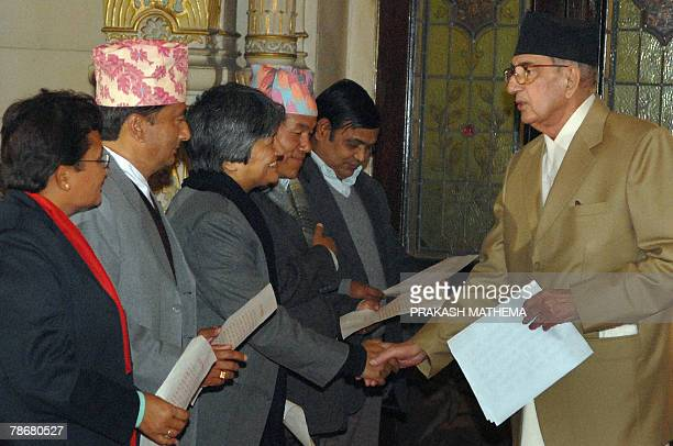 Nepalese Prime Minister Girija Prasad Koirala shakes hands after administering oaths of office to former rebel ministers Pampha Bhusal Minister for...