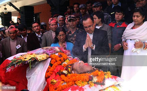 Nepalese Prime Minister Jhalanath Khanal and his wife Rabi Laxmi Chitrakar Khanal pay their last respects to late former prime minister and founder...