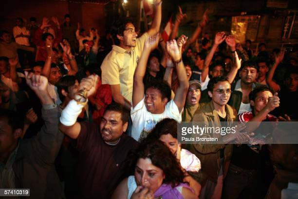 Nepalese pro-democracy supporters celebrate in the streets after King Gyanendra reinstated parliment after weeks of protests April 25, 2006 in...