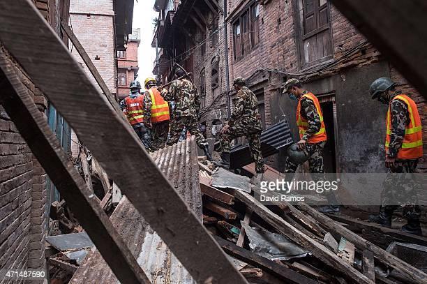 Nepalese Rangers soldiers walks among debris of houses on April 29, 2015 in Bhaktapur, Nepal. A major 7.8 earthquake hit Kathmandu mid-day on...