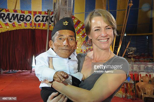 Nepalese resident and world's shortest adult Chandra Bahadur Dangi poses with a woman during a visit to a circus in Mumbai on March 18 2015 Dangi...