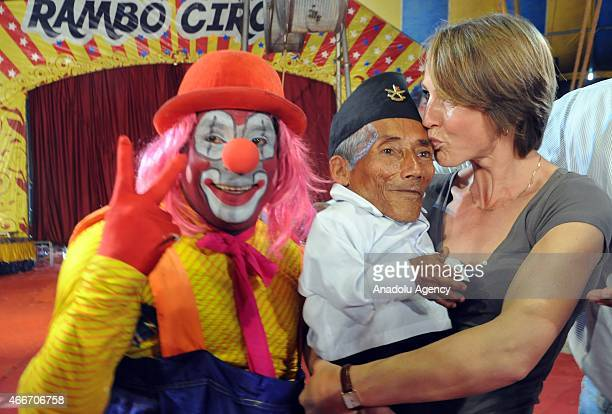 Nepalese resident and world's shortest adult Chandra Bahadur Dangi poses with a clown during a visit to a circus in Mumbai on March 18 2015 Dangi...