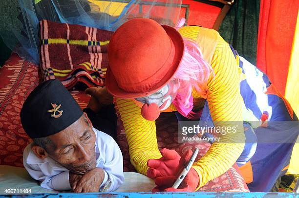Nepalese resident and world's shortest adult Chandra Bahadur Dangi looks on during a visit to a circus in Mumbai on March 18 2015 Dangi from a remote...